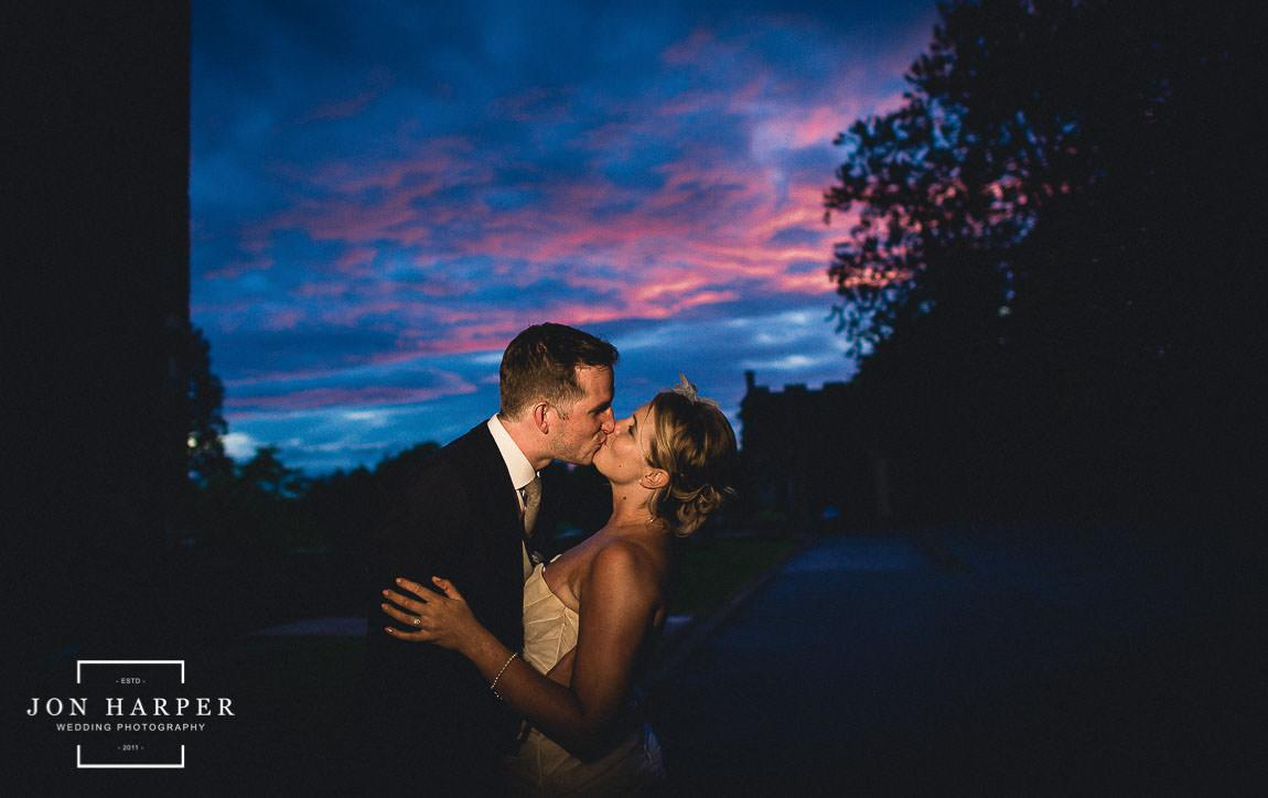 Wedding couple at sunset outside Berkeley Castle